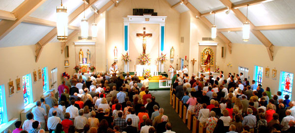 Rev. Michael Voithofer celebrates his first Mass at St. Hugh, his home parish, in 2010. Credit: Margie Rostosky