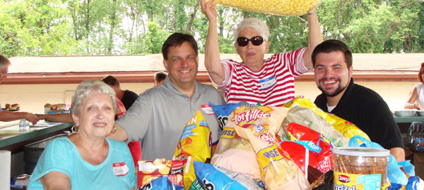 Stocked up for their parish picnic. (L-R) Judy Lee, Rev. Steve Kresak, Rita Woods and seminarian Joe Uzar.