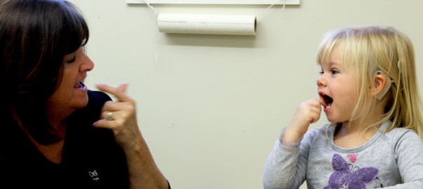 Teaching assistant Maria Supe works with Audrey Craig at the DePaul School for Hearing and Speech. Credit: DePaul School