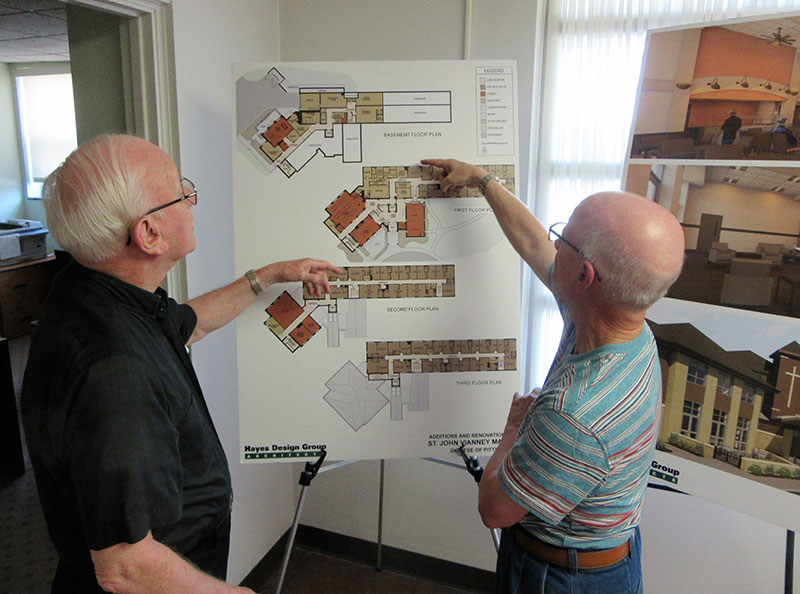 Auxiliary Bishop William Winter and Father Philip Przybyla review architectural plans for the renovation and expansion of St. John Vianney Manor. Photo Credit : Bob Dewitt