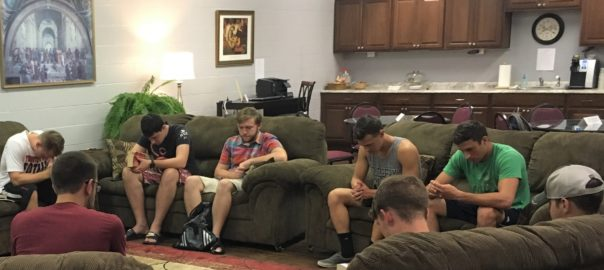 The men's Bible study group at Slippery Rock University prays at the start of their weekly meeting.  Photo credit: Jacob Grass, FOCUS.
