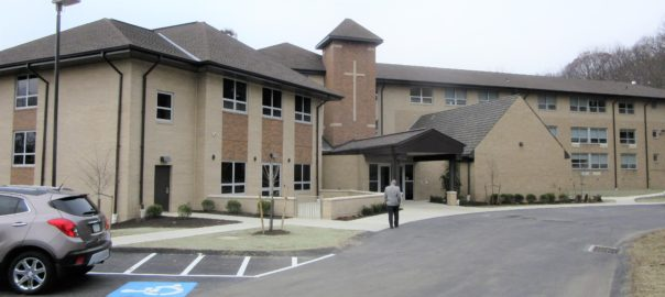The new wing, left, and entrance to St. John Vianney Manor.