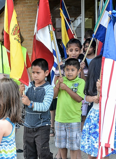 Local Latinos take part in a Eucharistic procession on June 3 at St. Catherine of Siena Parish in Beechview.